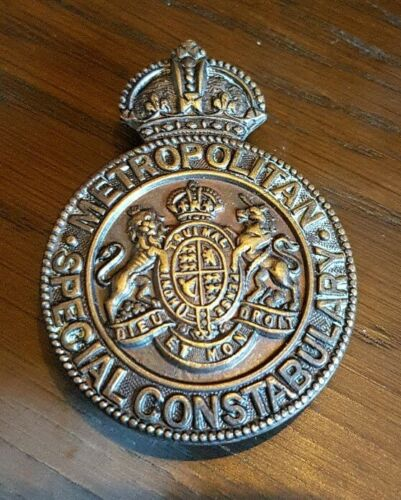 Metropolitan Police lapel badge.
