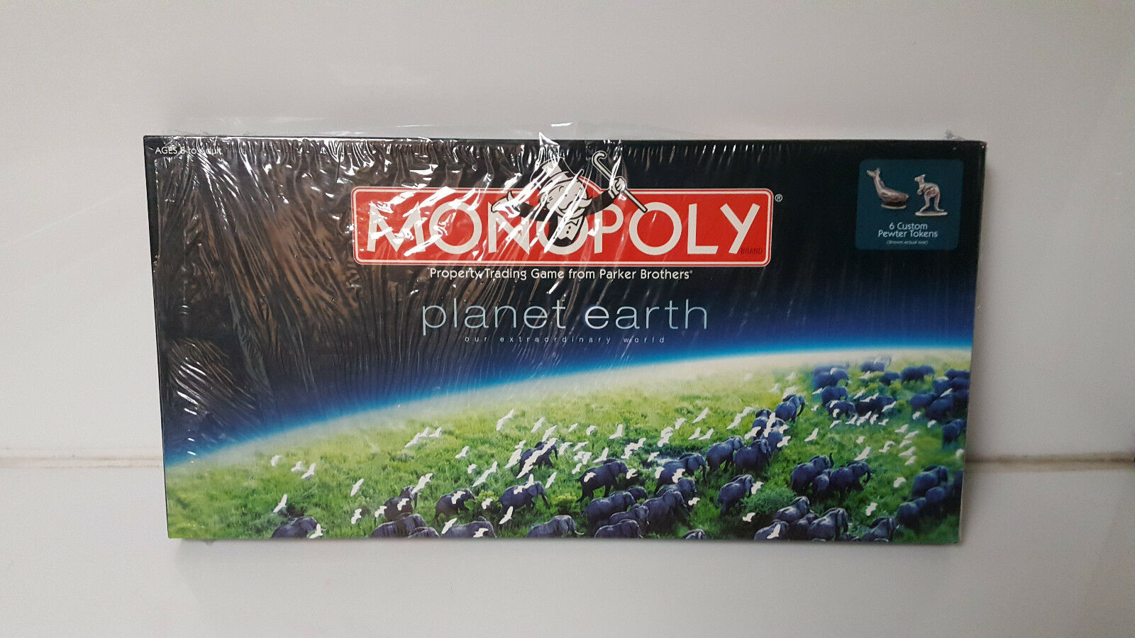 Monopoly Planet Earth new but cellophane is coming off