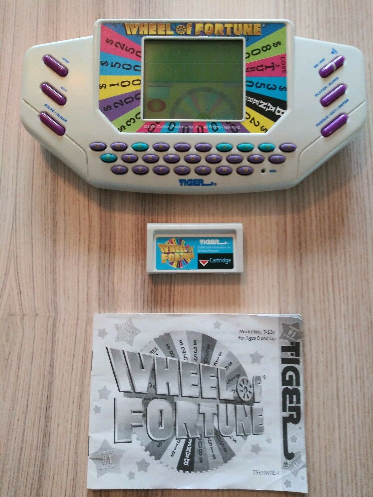 Vintage Tiger Electronics Wheel of Fortune Handheld Video Game & Manual