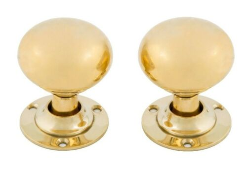 Undersized colonial heavy brass doorknobs and rosettes, unlacquered brass finish
