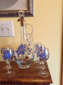 Beautiful vintage hand painted blue floral decanter and 5 glasses