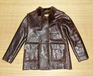 manteau fille CHRISTIAN LACROIX en vrai peau de mouton taille 8/10 ans