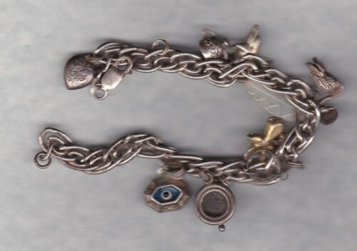 SILVER CHARM BRACELET WITH 10 CHARMS IN A WELL USED CONDITION