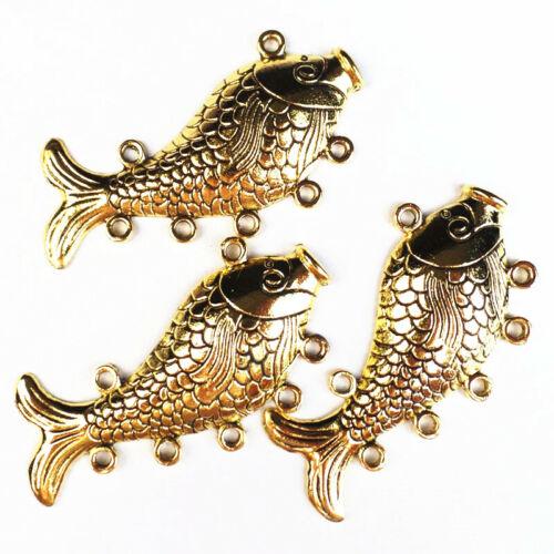 2Pcs Tallado tibetano peces colgante del grano oro 68x32x3mm zhx61507