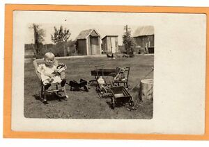 Real Photo Postcard RPPC - Girl in Rattan Rocker Dolls Toys Teddy Bear Outhouse