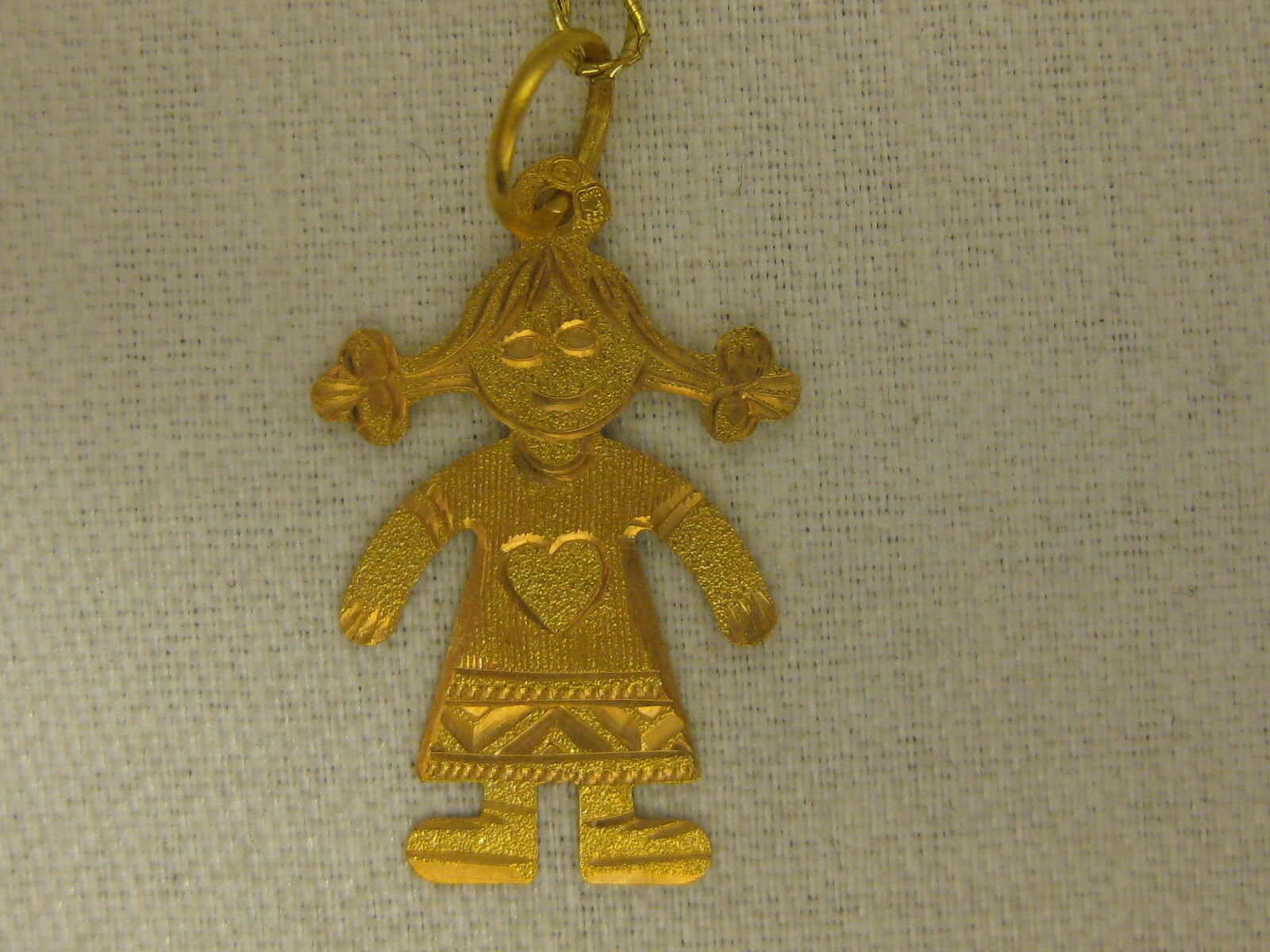 A NEW 19.2 KT GIRL CHARM FROM PORTUGAL