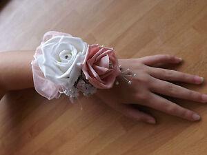 Wedding-flowers-bridesmaids-wrist-corsage-white-baby-pink-roses-diamante-pearls