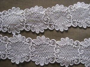 14 1//2 YDS SCALLOPED IVORY RAYON EMBRDROIDERED ON WHITE ORGANZA TRIM.