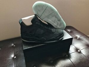 Air Jordan 4 X KAWS black glow in size 9.5 ORDER CONFIRMED FREE SHIPPING.