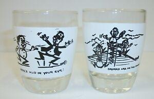 Set-2-Vintage-Novelty-Shot-Glasses-Mud-in-Eye-Drinks-on-House