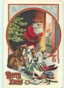 Santa-Claus-Peeks-at-Sleeping-Child-Toys-Antique-Emboss-Christmas-Postcard-c239