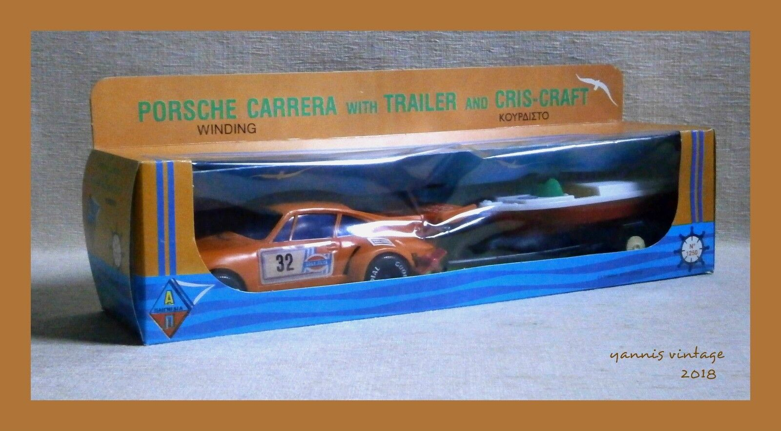 PORSCHE CARRERA & CHRIS-CRAFT   NIB Wind Up Greece Pappas Bros orange Greek