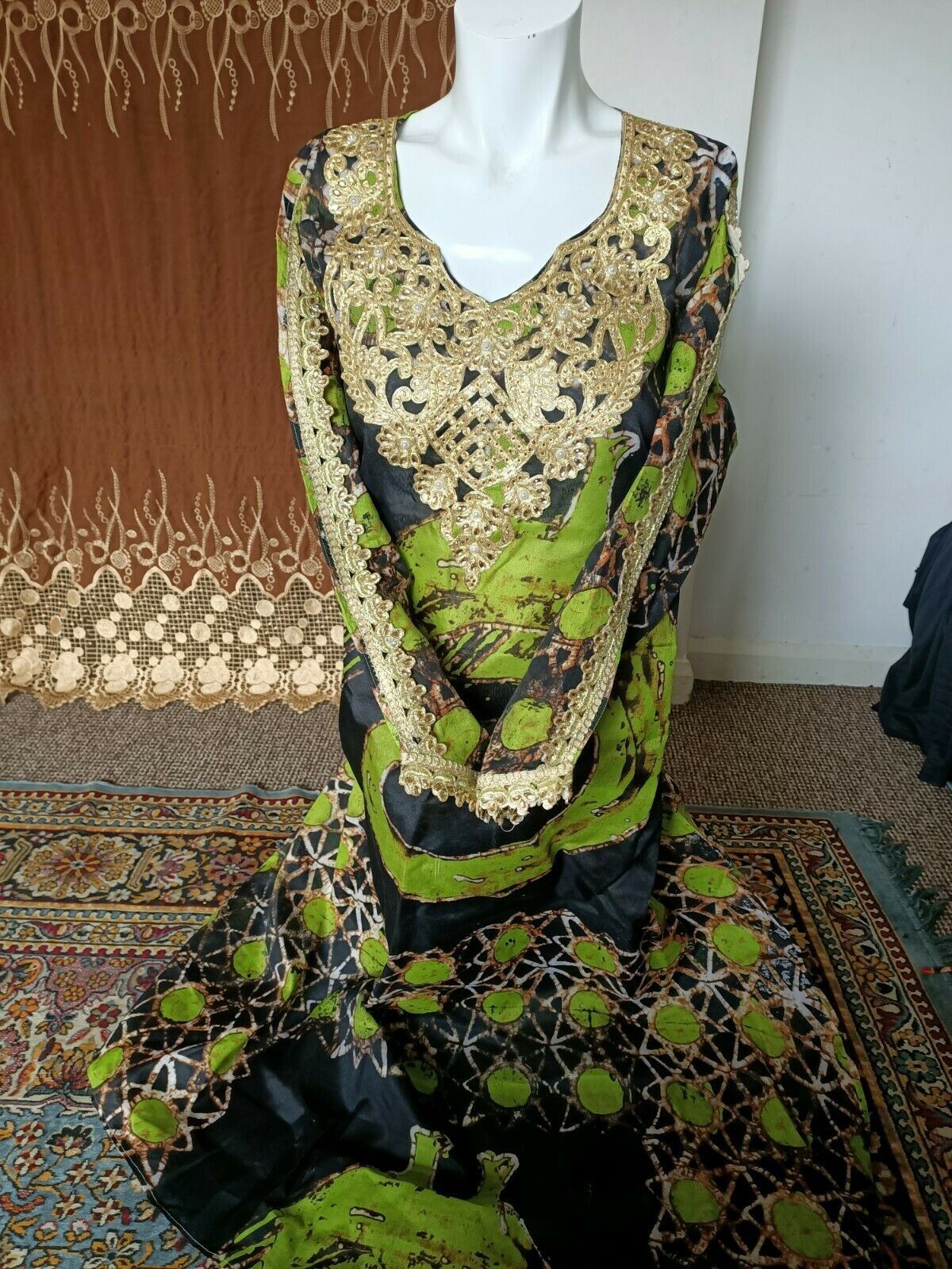 Ladies African long dress with gold details free Size fit chest up to 44Rins