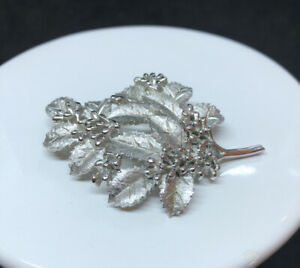Silver pin with branches and leaves