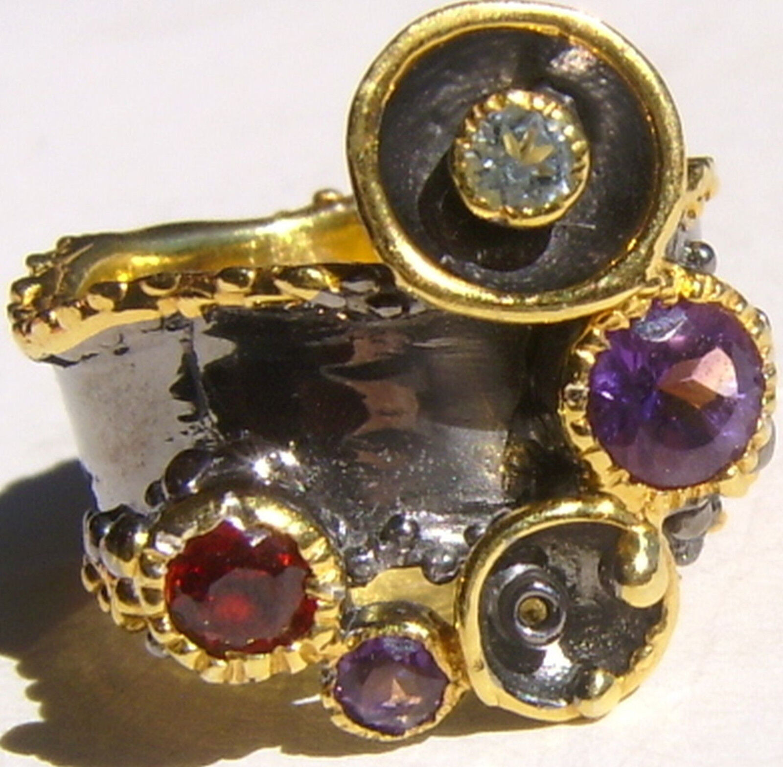 CeS Ring mit Amethyst, blueer Zirkon, Crimson Granat