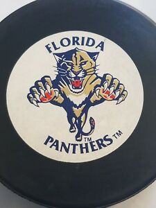 FLORIDA-PANTHERS-VINTAGE-TRENCH-CZECHOSLOVAKIA-HOCKEY-PUCK-NHL