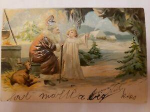 1905-Santa-Claus-Brown-Robe-Father-Christmas-Deer-Angel-in-Cave-Postcard-Embosse