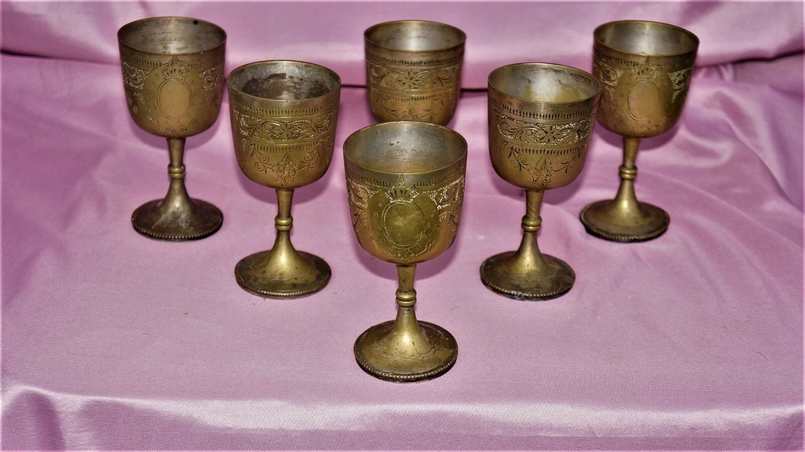 Six decorated Roman brass goblets pimp cup for a convivium wine drinking vessel