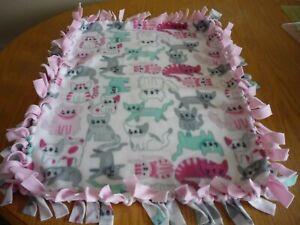 Handmade-fleece-tie-blanket-of-happy-kitty-for-a-small-pet