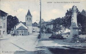 CPA-01-LHUIS-LA-PLACE-DE-L-039-EGLISE-ET-LE-MONUMENT