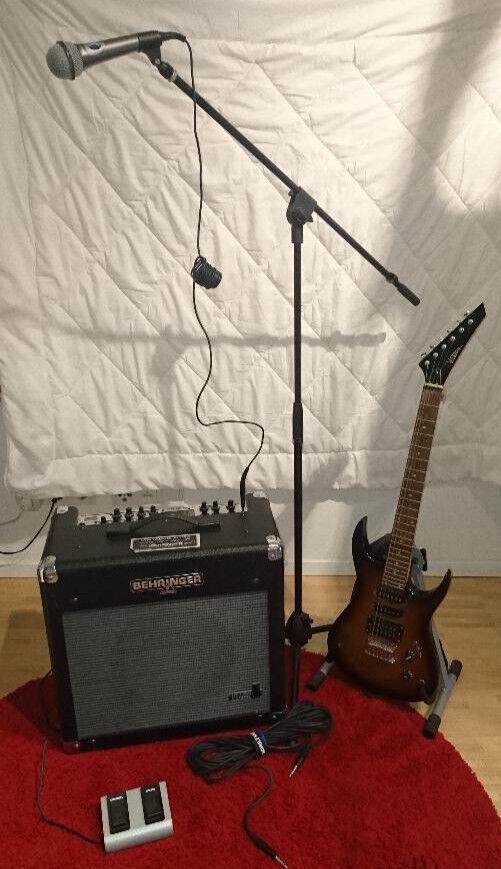 TOP E-Gitarre + Behringer Verstärker, Mikro inkl Ständer, Gitarrenständer uvm.