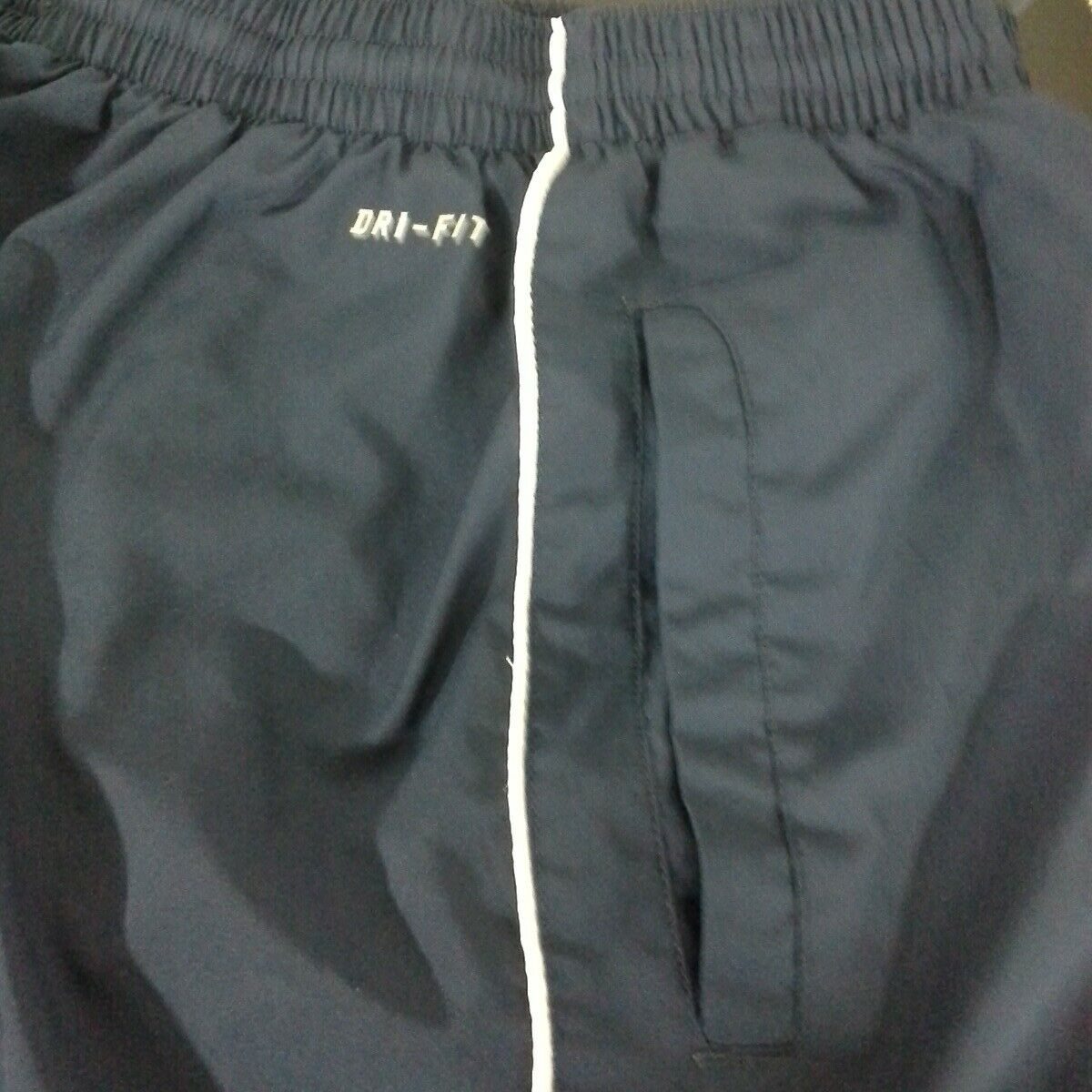Nike womens pants Size S Black White side piping Pull-on Elastic waist Zip ankle