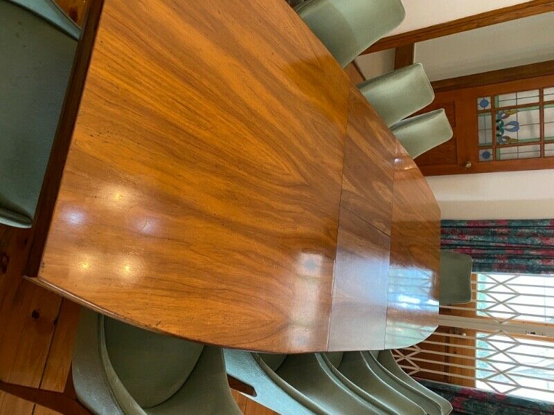 Solid 12 Seater extendable Rhodesian Teak Table in excellent condition.