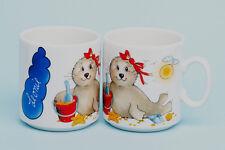 """Namensbecher Tasse Motiv /""""Seehund mit mit Herz Luftballon /"""" />Jeder Name möglich/<"""
