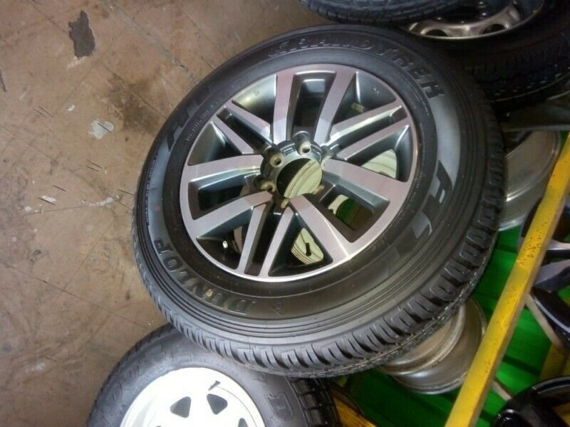 """18"""" Toyota Hilux/Fortuner original mag with brand new 265/65/18 Dunlop AT to use for spare"""