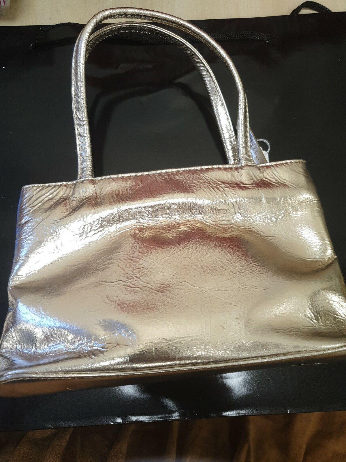 Taurus Gold Leather clutch 181