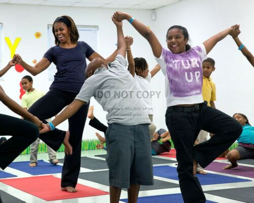 ZY-586 MICHELLE OBAMA JOINS CHILDREN FOR A YOGA CLASS IN MIAMI 8X10 PHOTO