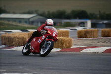 779098 Red Motorcycle Racing On Racetrack A4 Photo Print