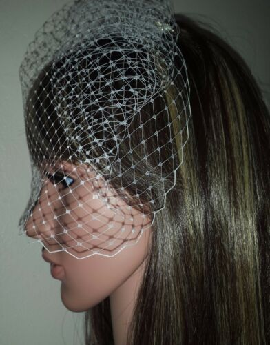 """Brides Ivory birdcage wedding veil 9/"""" Veil is attached to metal comb Fascinator"""