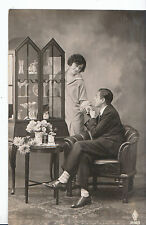 Romance Postcard - Young Man Sitting In Chair and A Young Lady Stood Up   MB1739