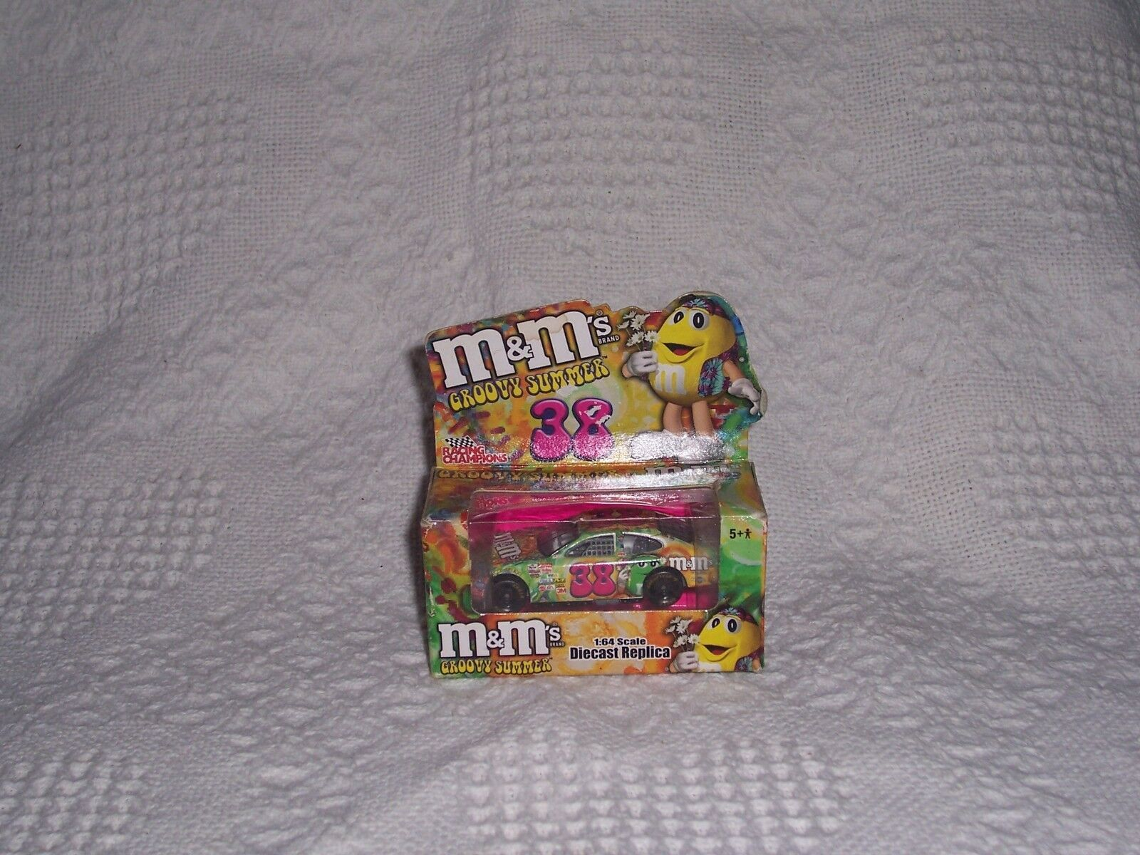 (108) NIP- M&M's Groovy Summer Ford Taurus-1 64 Diecast Replica - RC2 Brand