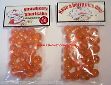 2 BAGS OF STRAWBERRY SHORTCAKE CARTOON ADVERTISING PROMO MARBLES