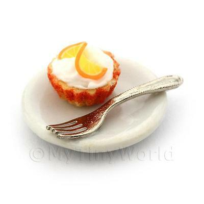 Miniature Orange Cream Cupcake In An Orange Paper Cup On A Plate With A Fork