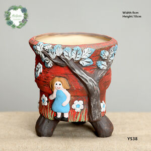Tall-creative-concrete-planter-Little-girl-pattern