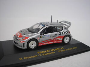 PEUGEOT-206-WRC-2-FINLAND-RALLY-2002-M-GRONHOLM-1-43-IXO-NEW