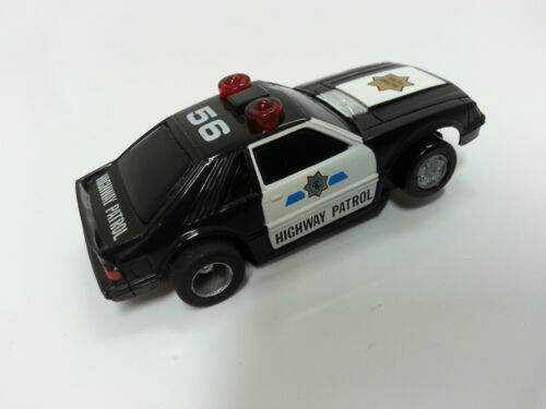 TYCO #56 policecar COMPLETE Uturn chassis//lights.NEW!