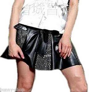 Schwingender-Mini-Rock-mit-Pailletten-Laenge-ca-41cm-Bundweite-ca-40cm