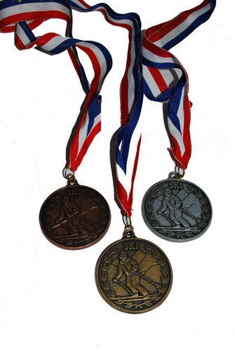 and Blue Ribbon White Alpine Ski Award Medals Mountain Background w//Red New