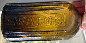 EARLY GOLDEN OLIVE GREEN SWAIM'S PANACEA PHILADa BOTTLE, PONTILED