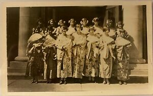 Group-of-Young-Women-Dressed-In-Japanese-Kimonos-Holding-Fans-Old-Photograph