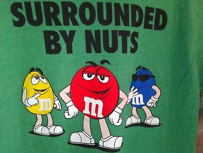 L green T Shirt M&M's candy FUNNY says SURROUNDED BY NUTS peanuts CARTOON tv AD