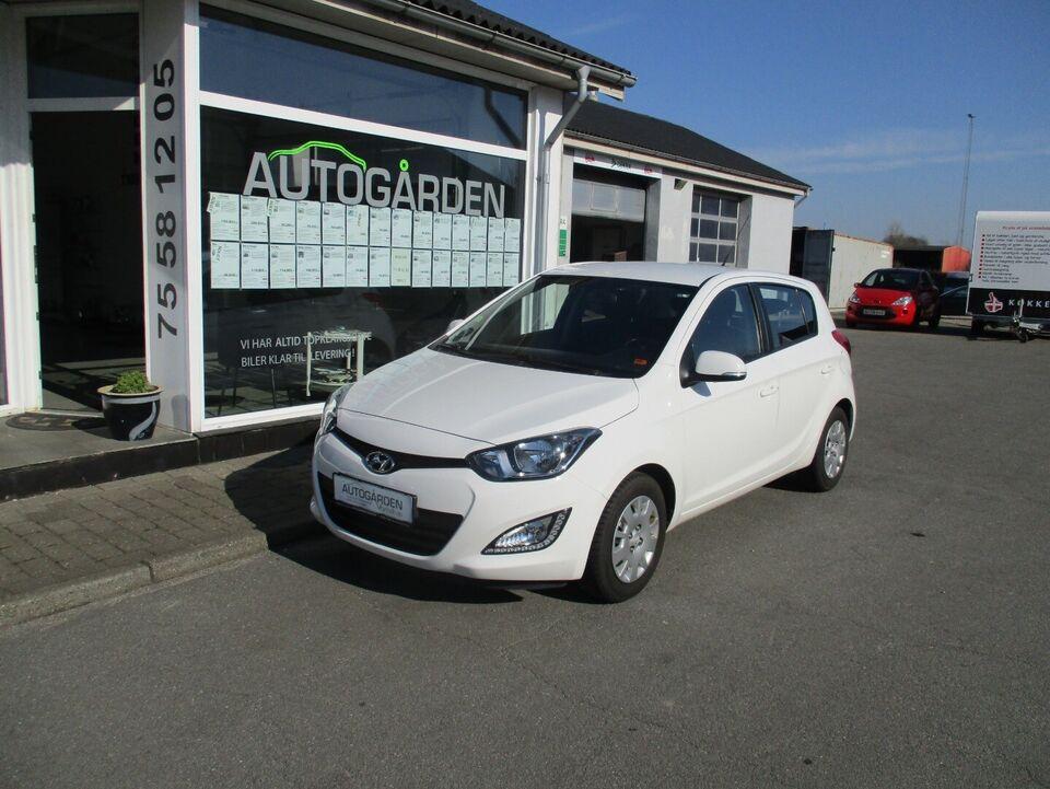 Hyundai i20 1,25 Comfort Benzin modelår 2013 km 125000 Hvid