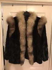 Woman's  Mink w/ fox fur trim coat size large barely worn excellent condition.