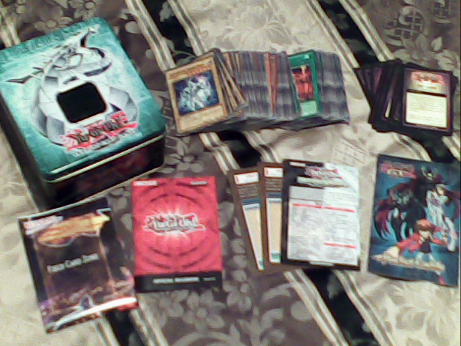 Yugioh lot of 156 cards, a collectable tin, and more