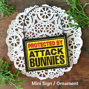 DECO Mini Fun Sign PROTECTED BY ATTACK BUNNIES Hanger Bunny Rabbit Ornament USA