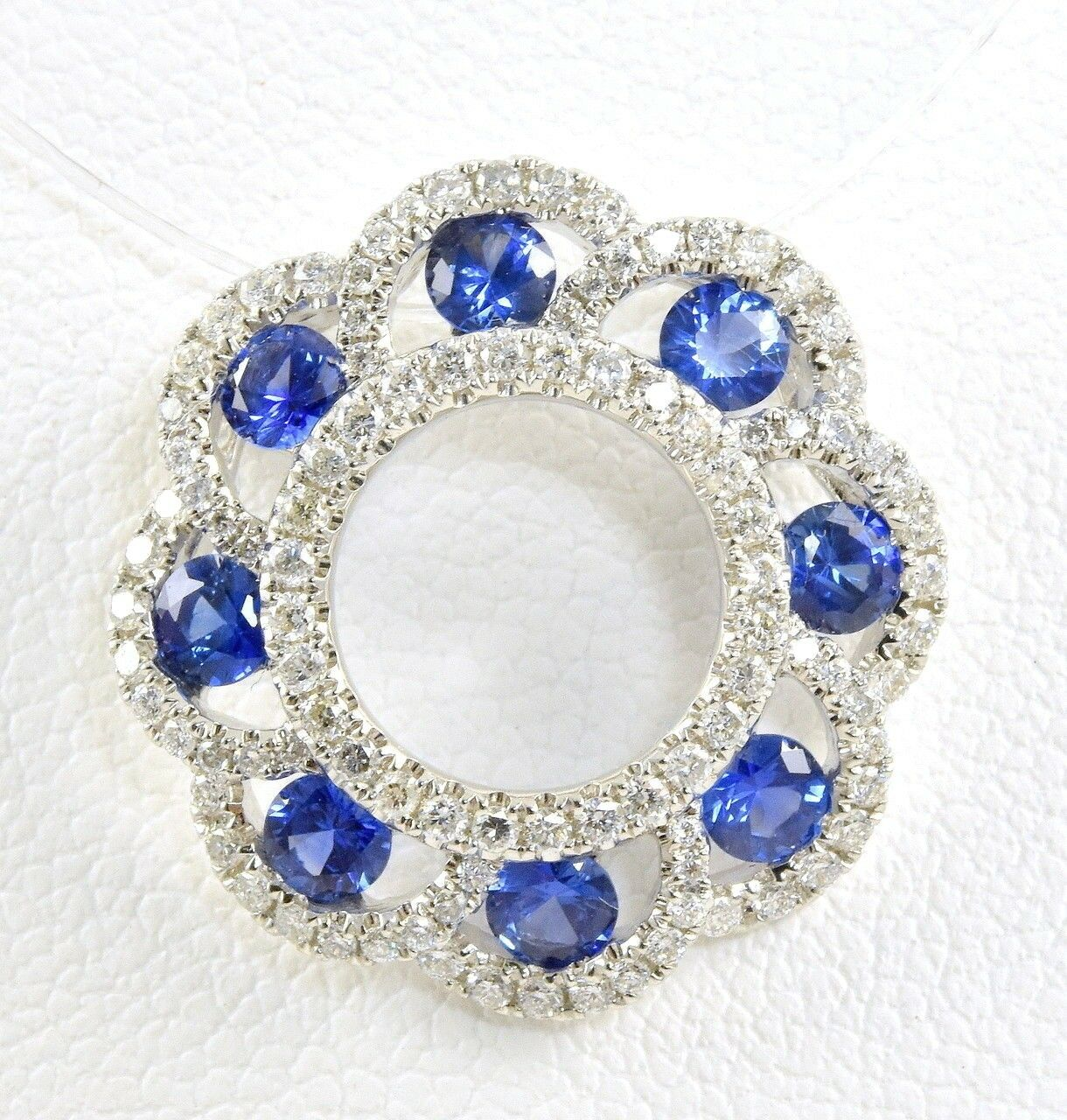 18K White gold 1.17 CT Sapphire &.60 CT Round Brilliant Diamond Wreath Pendant